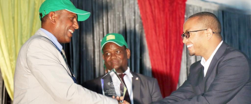 A man receives an award.
