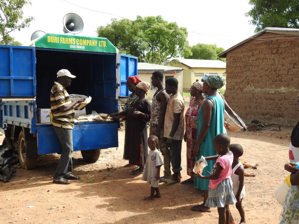 Photo of farmers buying seed from the seed van.