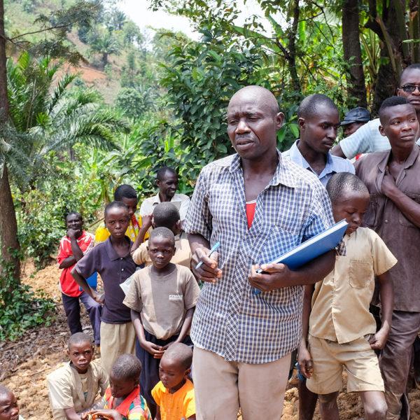 An instructor speaks to farmers in Benin.