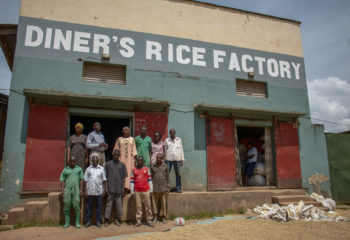 Workers at the Diner's Rice Factory stand in front of the business.