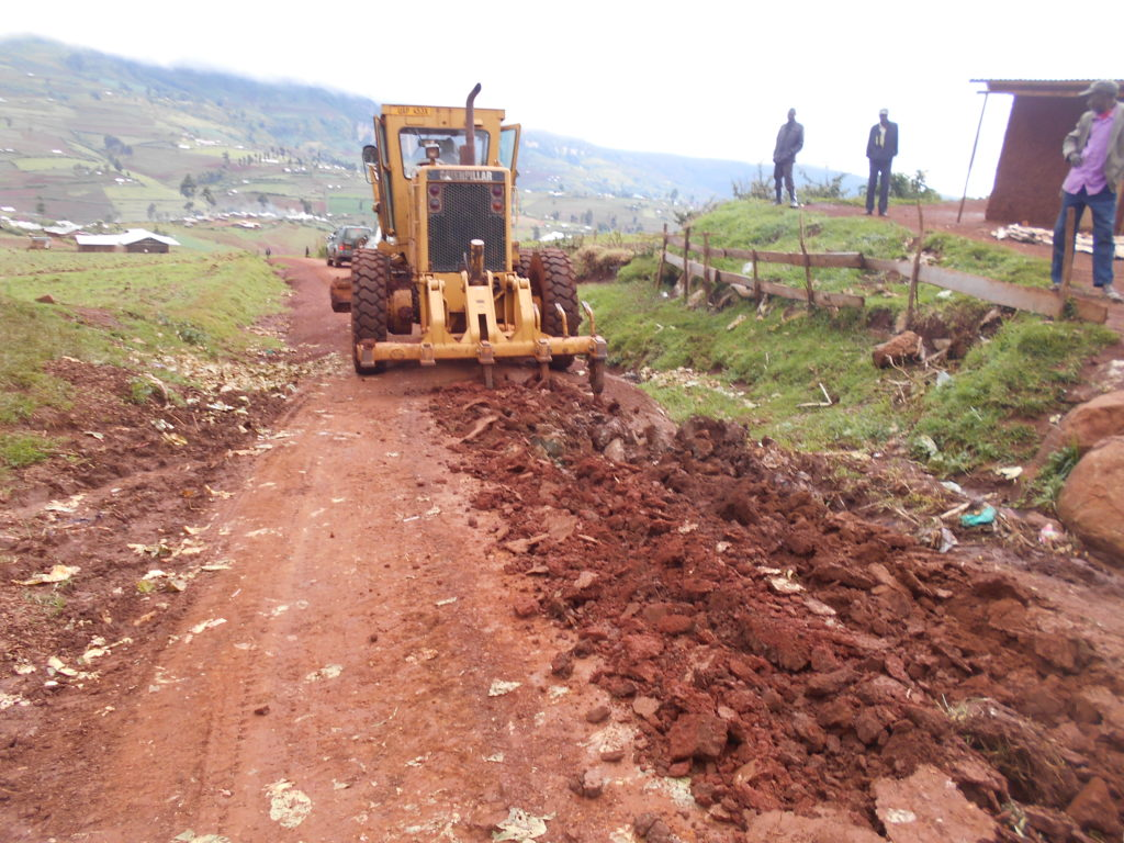 Machinery smooths a new road