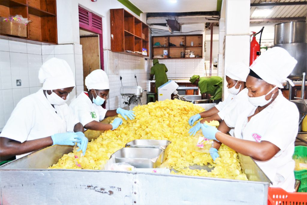Women pack potato cripss