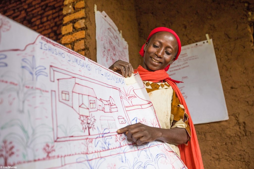 A woman displays her hand drawn plan