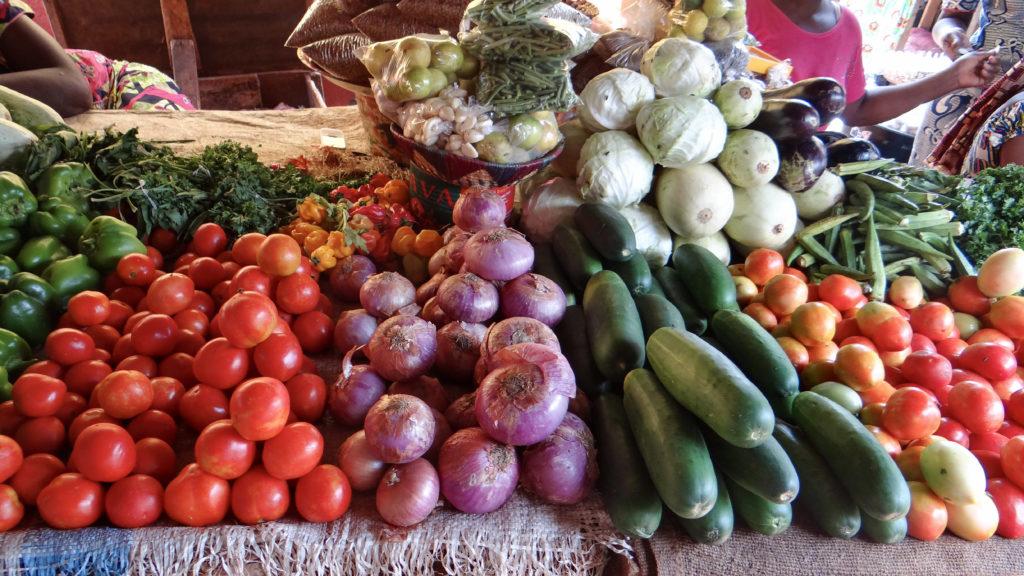 a market scene of various vegetables