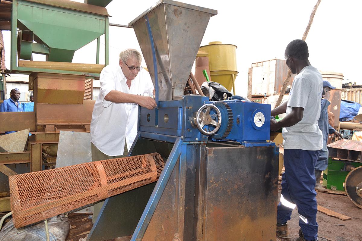 two men work on a machine
