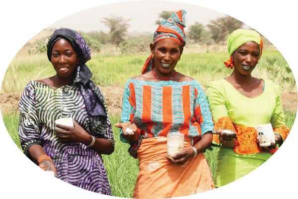 women farmers hold fertilizers